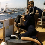 15 September 1962 The President and Mrs. Kennedy view the first of the 1962 America's Cup races aboard the USS Joseph P. Kennedy Jr., off Newport, Rhode Island. Photograph by Robert Knudsen, White House, in the John F. Kennedy Presidential Library and Museum, Boston.