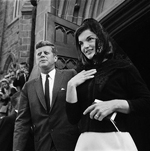 Kennedy's attend Mass. Newport, R.I.: President and Mrs. Kennedy leave St. Mary's Roman Catholic Church in Newport after attending Mass. Sermon was on the similarities and differences between public and parochial schools. The First Lady wore a white flannel dress, banded in black satin with a black jacket. On her head she wore a black mantilla. September 9, 1962 Newport, Rhode Island, USA
