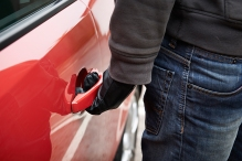 Car Thief Trying Door Handle To See If Vehicle Is Unlocked